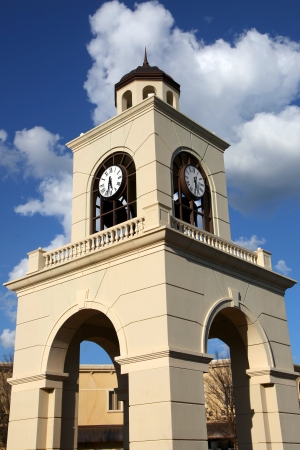 mississippi: Modern clock tower structure against blue sky