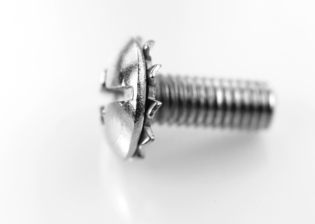Close up shot of small metal screw photo