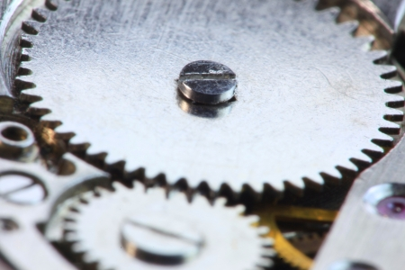 Extreme close up shot of two mating watch gears 版權商用圖片
