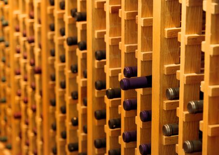 Yellow Racks with bottles in a wine cellar photo