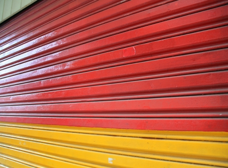 shutter door: Colorful shop shutter door perspective background