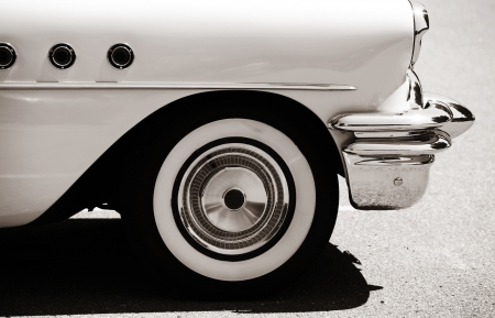 Side view of classic car with front wheel photo