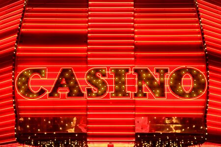 Casino entrance sign in red neon lights Stock Photo