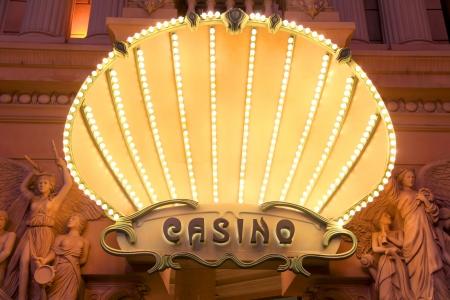 Illuminated Casino entrance board with elegant architecture