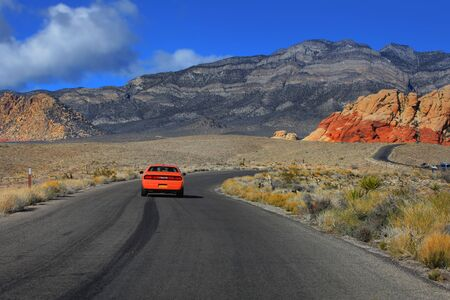 cody: Winding road through red rock canyon