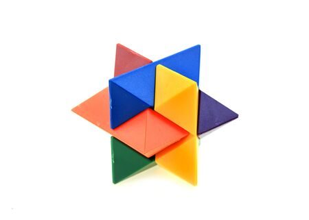 child s block: Colorful plastic puzzle on white background
