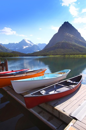 Canoes by lake Mc Donald in Glacier national park photo