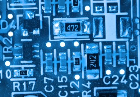 Extreme close up shot of electronic circuit board photo