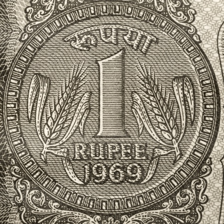 One rupee coin symbol on the note Stock Photo - 20655180