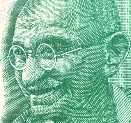 Gandhi impression from five rupee note photo