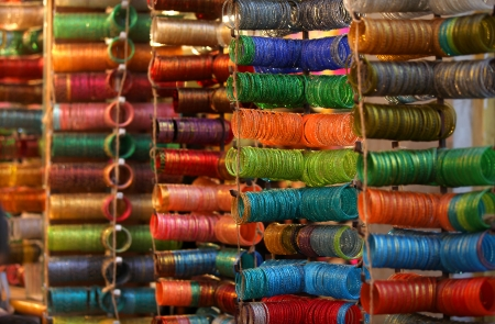 Colorful bangles are up for sale out side the store photo
