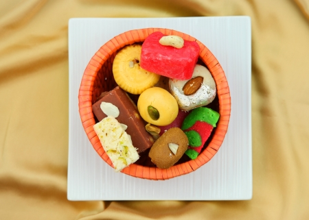 Colorful Indian sweets in the plate photo