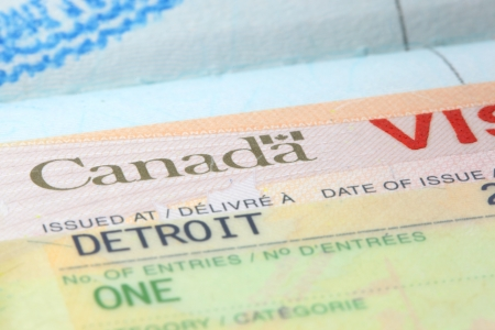 Close up shot of Canadian visa stamp photo