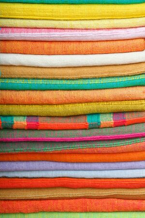 cotton fabric: Stack of colorful cotton fabrics Stock Photo