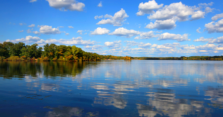 Panoramic view of autumn tree reflections Stock Photo