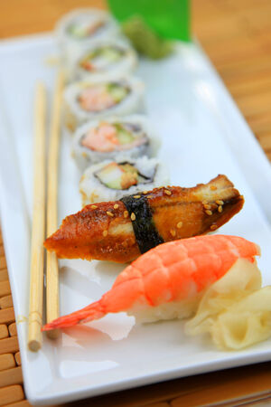 Arrangement of assorted sushi on the plate photo