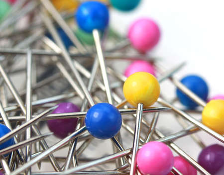 thin bulb: Colorful pins against white background