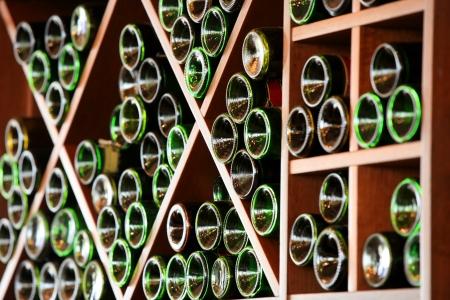 wine making: Lots of wine bottles stored in the racks Stock Photo