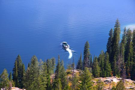 jenny: Boat in Jenny lake at foot hills of Grand Tetons Stock Photo