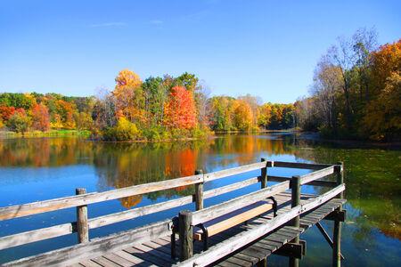 Board walk near the lake in autumn time photo