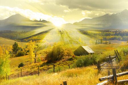 ethno: Beautiful autumn landscape with sun rays Stock Photo