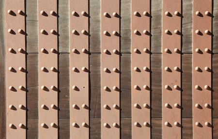 rivets: background of antique door with metal rivets