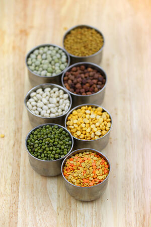 Different lentils in the small tumblers photo