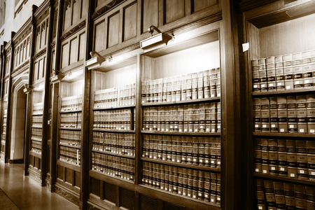 business law: Law book library in sepia color Stock Photo