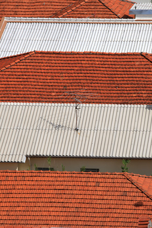 asbestos: Row of roofs with tiles and sheets Stock Photo