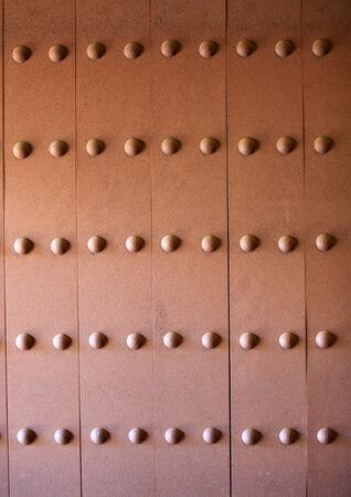 rivets: Background of rusty metal door with rivets