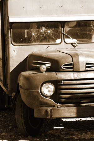 Old classic abandoned truck in sepia color photo