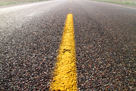 dividing: Yellow road dividing line on a desert road