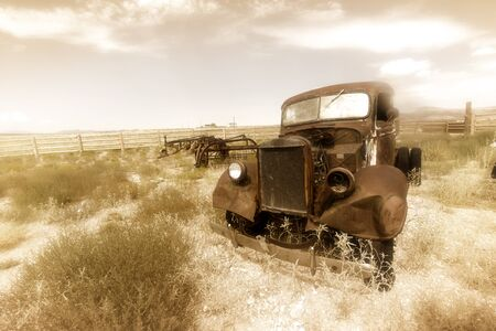 junk yard: Old rusty car by historic Route 66