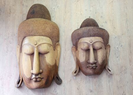 wood carvings: Two Buddha wood carvings on the wall Stock Photo