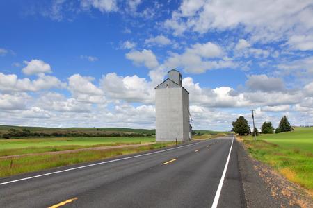 colfax: Tall grain silo by the road