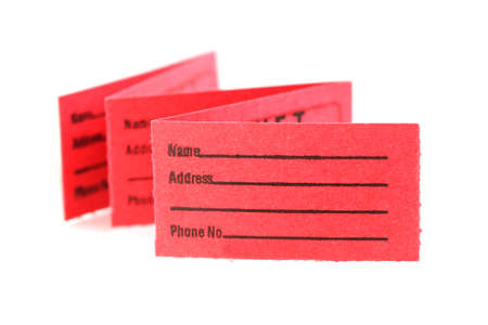 admittance: Red folded coupons on white background