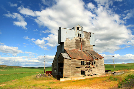 building structures: Old abandoned,wrecked barn in the fields Stock Photo
