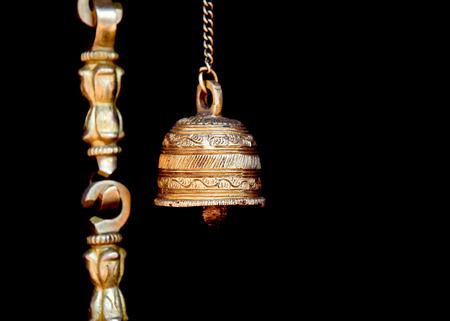 bell bronze bell: Bronze hindu holy bell against black background Stock Photo