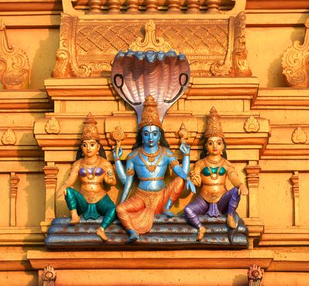gold colour: Lord Vishnu statue