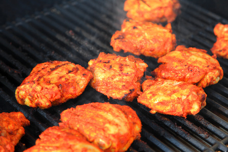 tandoori chicken: Tandoori style chicken on the grill Stock Photo