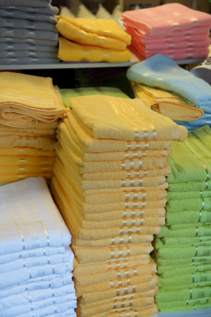 Stack of colorful towels up for sale