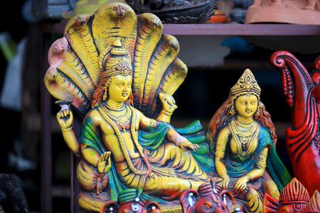 Colorful statue of hindu god Vishnu and Goddess Lakshmi Stock Photo