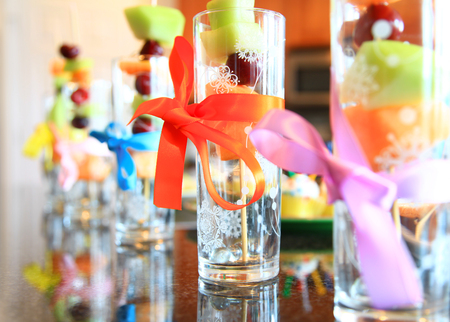 rainbow cocktail: Decoration of fruit glasses in a row
