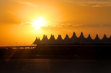 denver at sunrise: Denver airport against sun set background Stock Photo