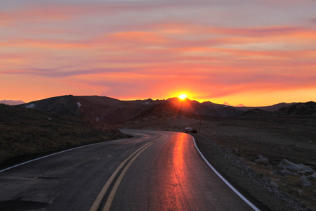 hairpin: Mountain road under sun set