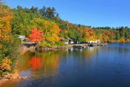 Scenic Little Squam lake in New Hampshire in autumn time Save Comp