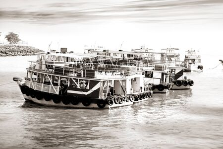 water transportation: Tourist boats at Mumbai shore line in monochrome
