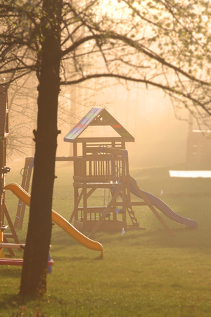 Childrens play place caught in fog
