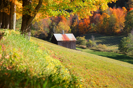Old barn nestled in  Vermont mountains Stock Photo