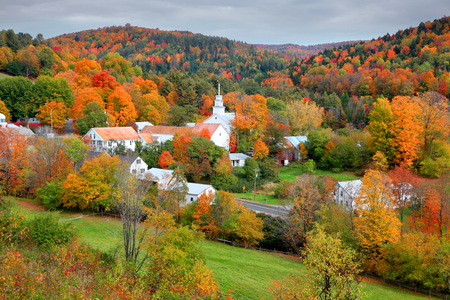 Small church in Topsham village in Vermont in the middle of fall foliage